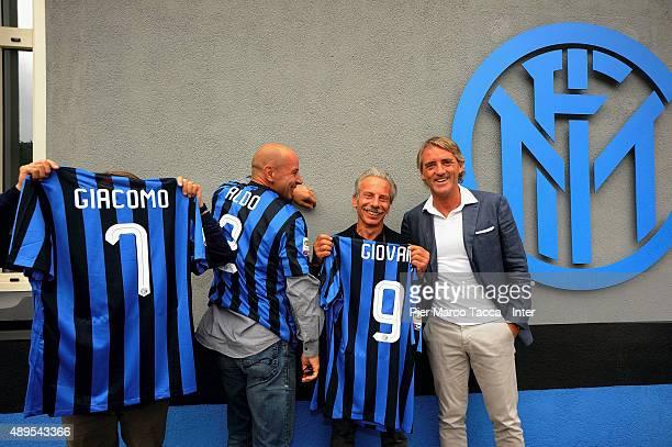 Aldo Baglio Giacomo Poretti Giovanni Storti and head coach of FC Internazionale Roberto Mancini pose before the FC Internazionale Training session at...