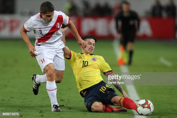 Aldo Corzo of Peru fights for the ball with James Rodriguez of Colombia during a match between Peru and Colombia as part of FIFA 2018 World Cup...