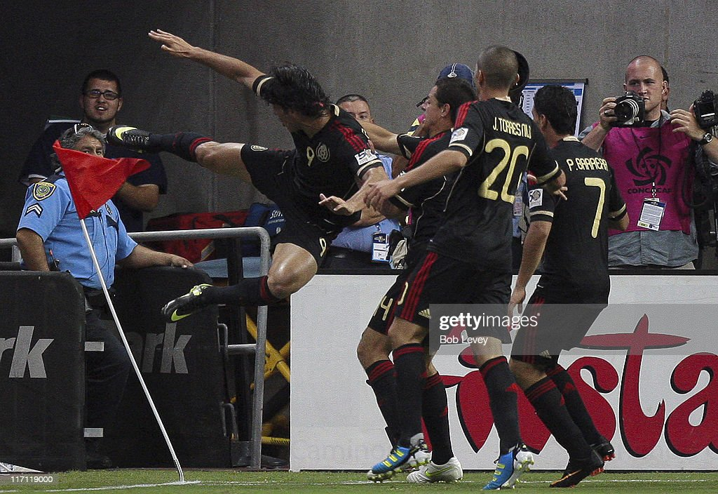 Aldo De Negris #9 of Mexico kicks the corner flag as he celebrates with <a gi-track='captionPersonalityLinkClicked' href=/galleries/search?phrase=Jorge+Torres&family=editorial&specificpeople=540782 ng-click='$event.stopPropagation()'>Jorge Torres</a> Nilo #20 and <a gi-track='captionPersonalityLinkClicked' href=/galleries/search?phrase=Pablo+Barrera&family=editorial&specificpeople=4388462 ng-click='$event.stopPropagation()'>Pablo Barrera</a> #7 after scoring in the first overtime period against Honduras at Reliant Stadium on June 22, 2011 in Houston, Texas. Mexico won 2-0.