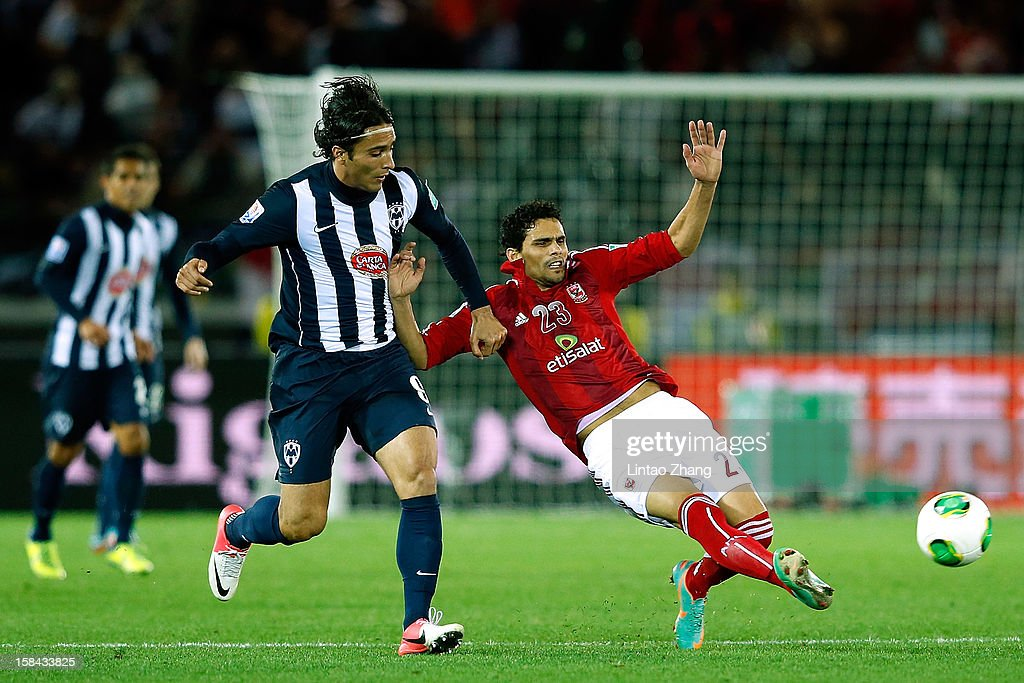 Aldo De Nigris (L) of Monterrey challenges Mohamed Naguib of Al-Ahly SC during the FIFA Club World Cup 3rd Place Match between Al-Ahly SC and CF Monterrey at International Stadium Yokohama on December 16, 2012 in Yokohama, Japan.