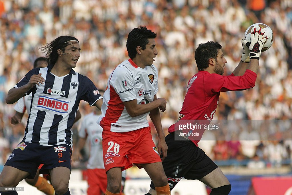 Aldo de Nigris (L) of Monterrey struggles for the ball with Marvin Cabrera (C) and Jorge Villalpando (R) of Jaguares during a match as part of the Apertura 2010 at Tecnologico Stadium on August 28, 2010 in Monterrey, Mexico.