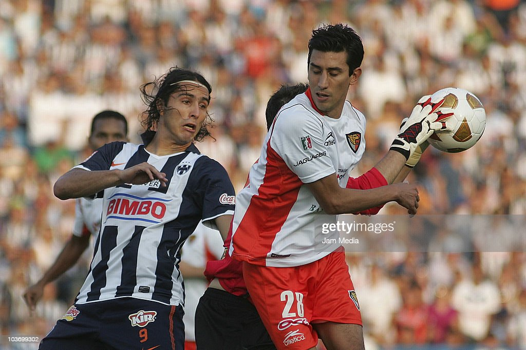 Aldo de Nigris (L) of Monterrey struggles for the ball with Marvin Cabrera (R) of Jaguares during a match as part of the Apertura 2010 at Tecnologico Stadium on August 28, 2010 in Monterrey, Mexico.
