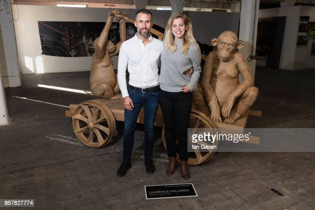 Aldo del Bo Managing Director of Kaspersky and Canadian artist Laurence Vallieres stand with her 'Transient Tales' piece at Moniker Art Fair 2017 as...