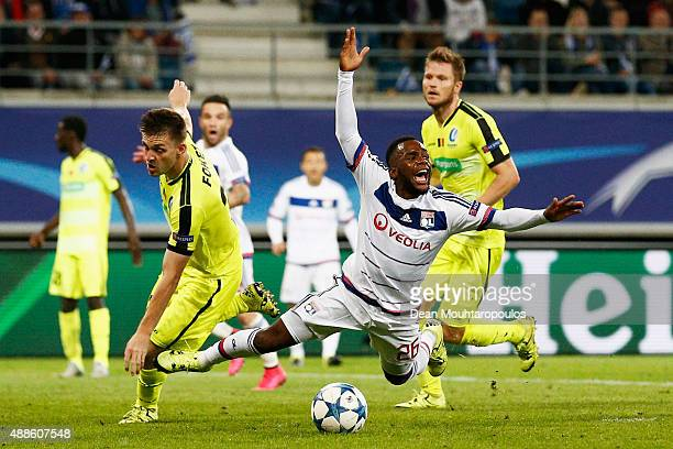 Aldo Kalulu of Lyon is fould in the box by Thomas Foket of Gent during the UEFA Champions League Group H match between KAA Gent and Olympique...