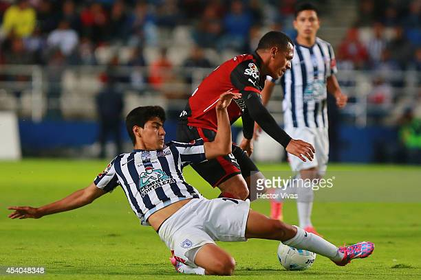 Aldo Leao of Atlas struggles for the ball with Rodolfo Pizarro of Pachuca during a match between Pachuca and Atlas as part of 6th round Apertura 2014...