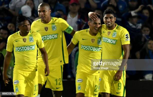 Aldo Leao Ramirez of Atletico Nacional celebrates with teammates after scoring his team's winning goal during the match between Millonarios and...