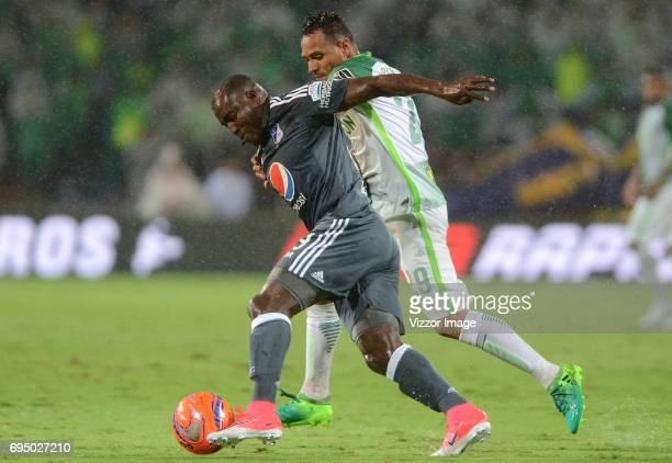 Aldo Leao Ramirez of Atletico Nacional fights for the ball with Eliser Quiñonez of Millonarios during the semi finals second leg match between...