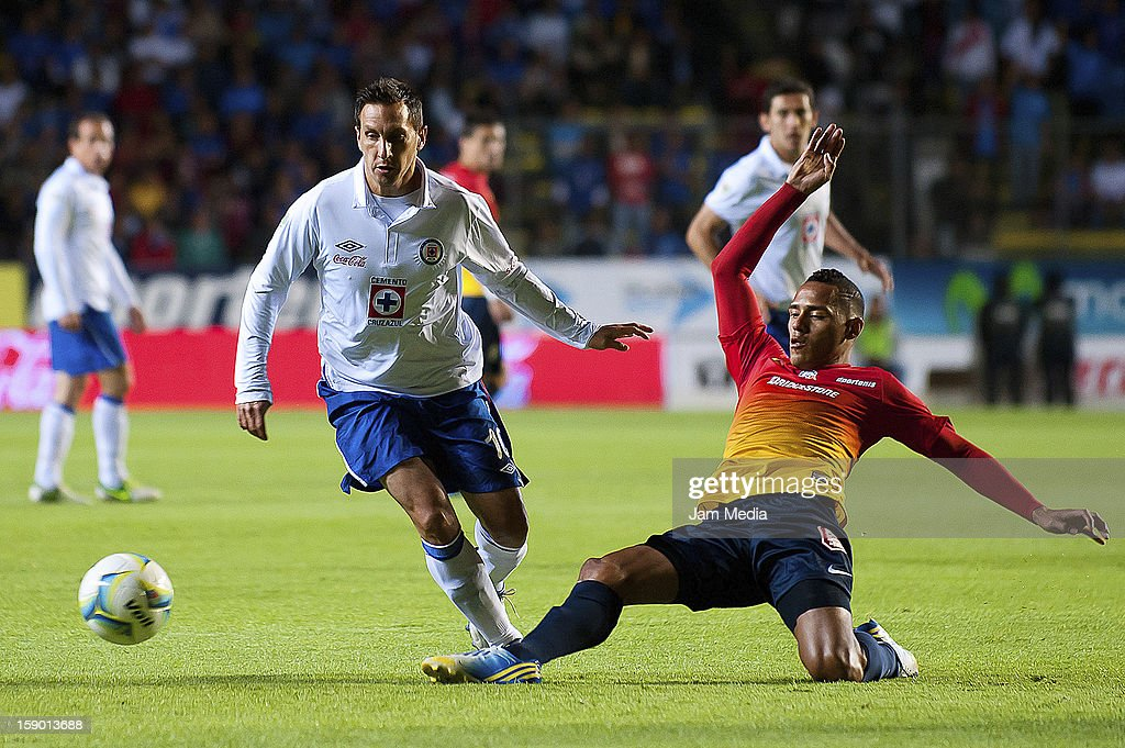Aldo Leo Ramirez (R) of Morelia struggles for the ball with Christian Gimenez (L) of Cruz Azul during the Clausura 2013 Liga MX at Morelos Stadium on january 04, 2013 in Morelia, Mexico.
