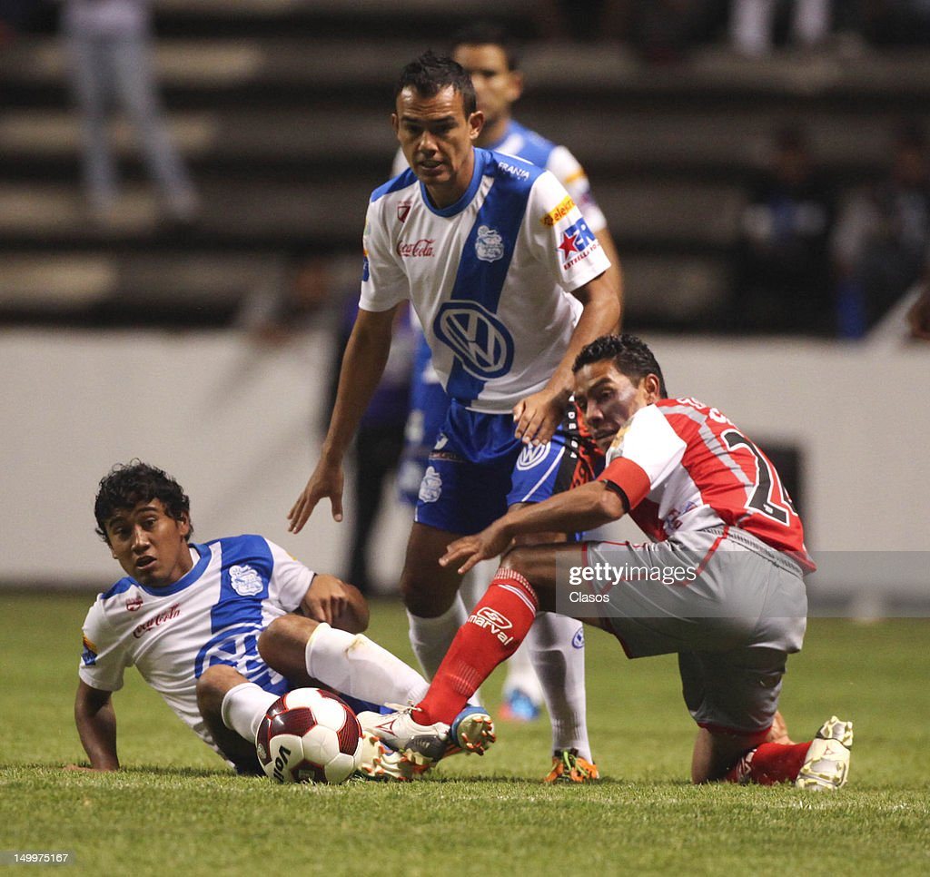 Aldo Polo of Puebla (L) struggle for the ball with Jose Cruzalta of Lobos (R) during a match between Puebla and Lobos BUAP as part of the Copa MX 2012 at Cuauhtemoc Stadium on August 07, 2012 in Puebla, Mexico.