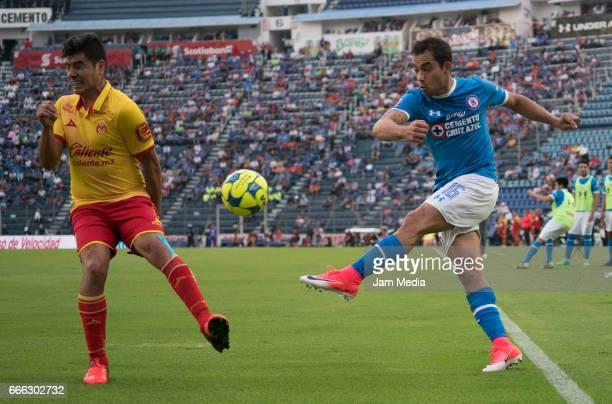 Aldo Rocha of Morelia tries to blcok a ball by Adrian Aldrete of Cruz Azul during the 13th round match between Cruz Azul and Morelia as par of the...