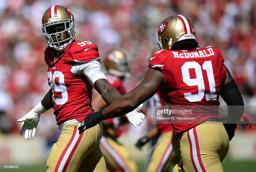 Aldon Smith #99 and Ray McDonald #91 congratulates each other after they sacked Andrew Luck quarterback of the Indianapolis Colts during the first quarter at Candlestick Park on September 22, 2013 in San Francisco, California.