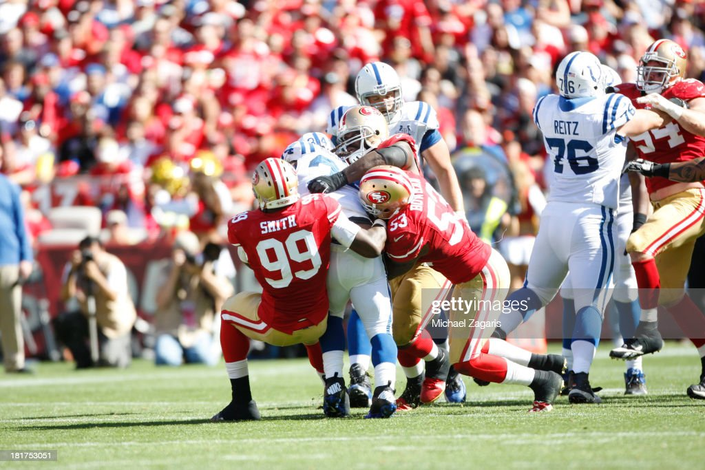 Aldon Smith #99, NaVorro Bowman #53 and Glenn Dorsey #90 of the San Francisco 49ers tackles Trent Richardson #34 of the Indianapolis Colts during the game at Candlestick Park on September 22, 2013 in San Francisco, California. The Colts defeated the 49ers 27-7.