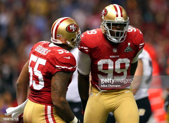 Aldon Smith of the San Francisco 49ers celebrates a sack with teammate Ahmad Brooks against the Baltimore Ravens during Super Bowl XLVII at the...