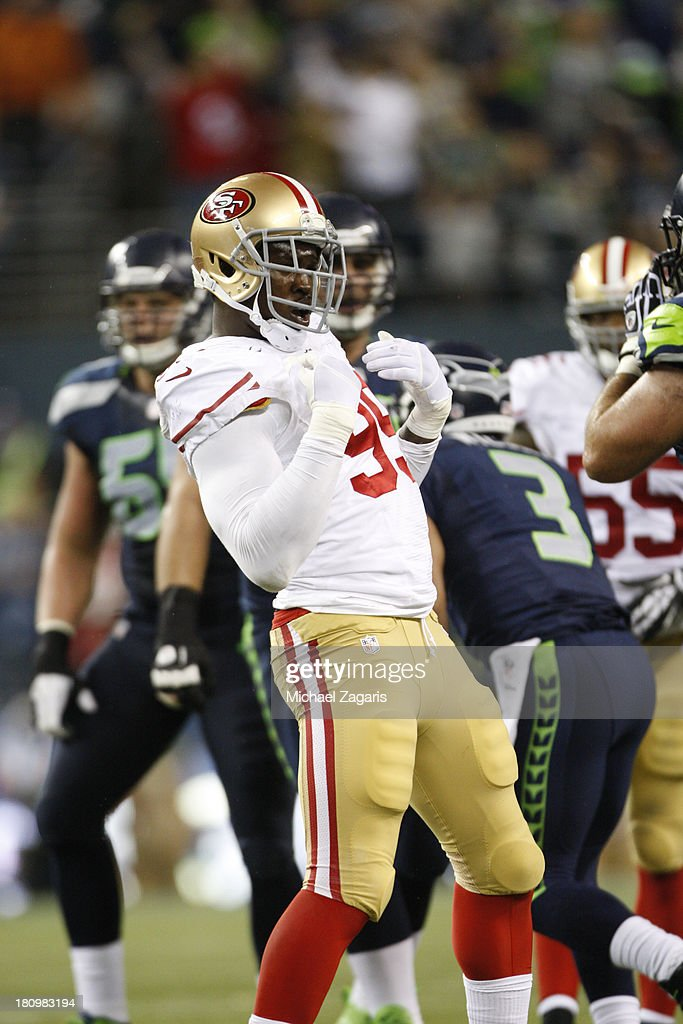Aldon Smith #99 of the San Francisco 49ers celebrates after sacking Russell Wilson #3 of the Seattle Seahawks during the game at CenturyLink Field on September 15, 2013 in Seattle, Washington. The Seahawks defeated the 49ers 29-3.
