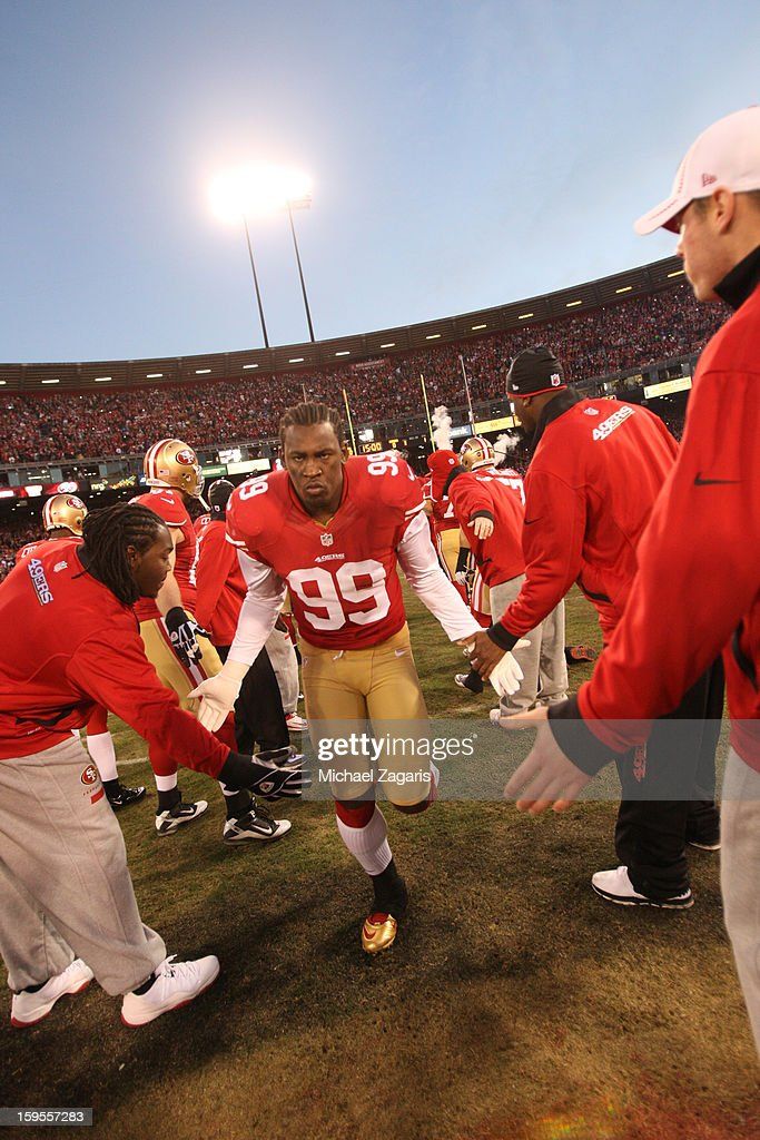 Aldon Smith #99 of the San Francisco 49ers is introduced prior to the game against the Green Bay Packers at Candlestick Park on January 12, 2012 in San Francisco, California. The 49ers defeated the Packers 45-31.
