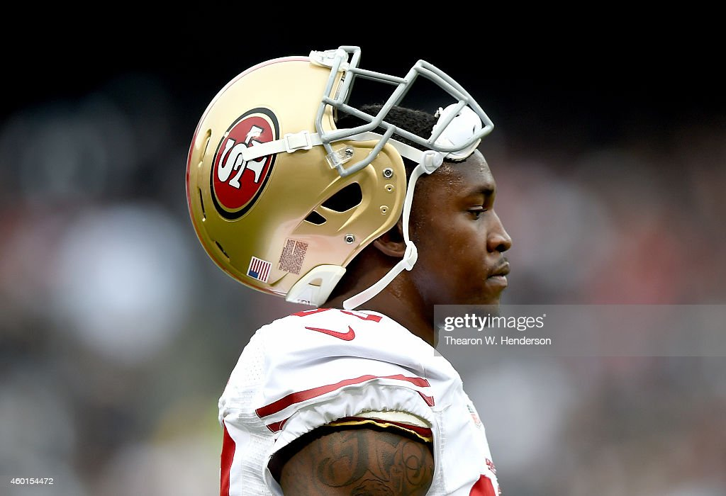 Aldon Smith of the San Francisco 49ers looks on during a timeout against the Oakland Raiders at Oco Coliseum on December 7 2014 in Oakland California