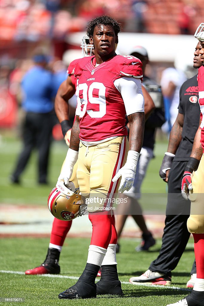 Aldon Smith #99 of the San Francisco 49ers looks on during warm-ups against the Indianapolis Colts at Candlestick Park on September 22, 2013 in San Francisco, California.