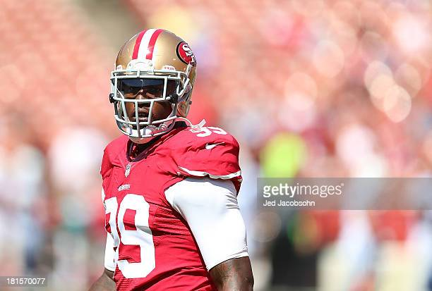 Aldon Smith of the San Francisco 49ers looks on during warmups against the Indianapolis Colts at Candlestick Park on September 22 2013 in San...