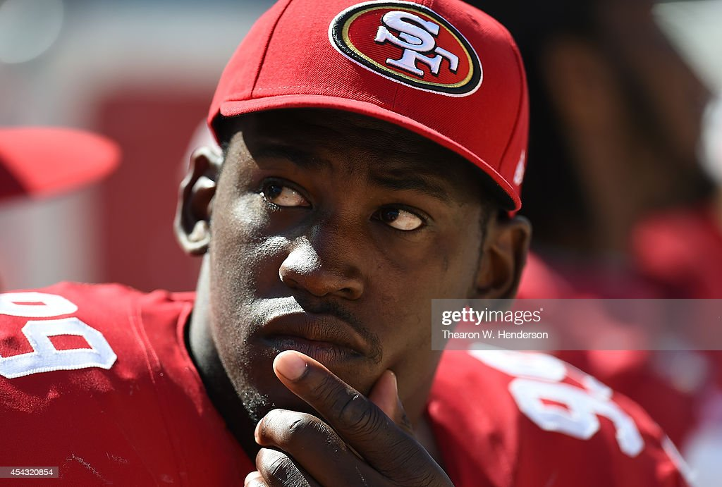 Aldon Smith of the San Francisco 49ers looks on from the bench against the San Diego Chargers during the fourth quarter of a preseason game on August...