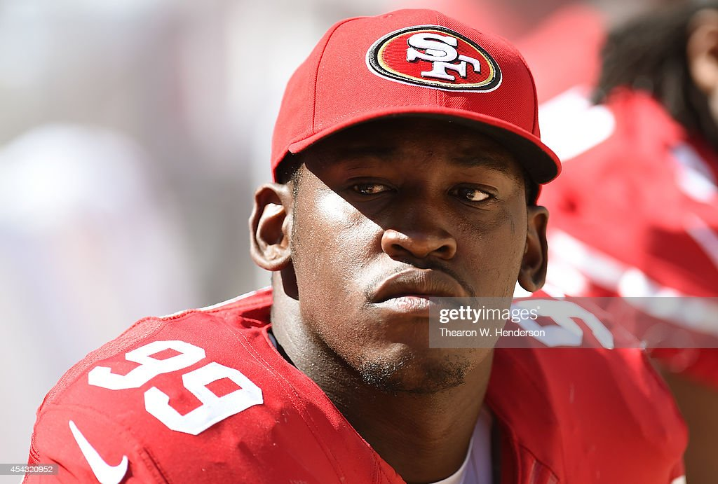 <a gi-track='captionPersonalityLinkClicked' href=/galleries/search?phrase=Aldon+Smith&family=editorial&specificpeople=6522981 ng-click='$event.stopPropagation()'>Aldon Smith</a> #99 of the San Francisco 49ers looks on from the bench against the San Diego Chargers during the fourth quarter of a preseason game on August 24, 2014 in Santa Clara, California.