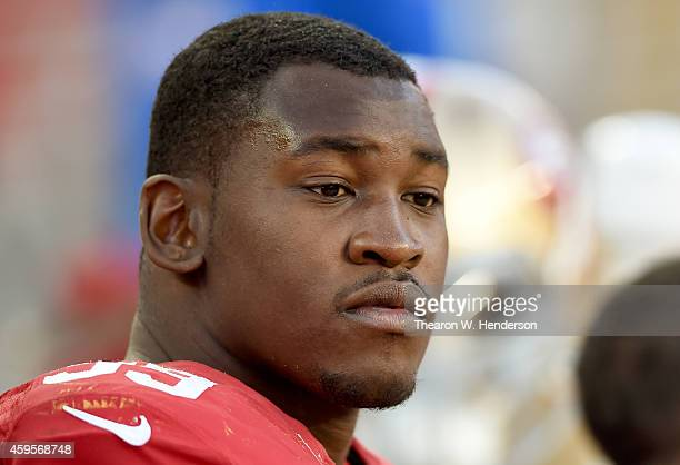 Aldon Smith of the San Francisco 49ers looks on from the bench against the Washington Redskins at Levi's Stadium on November 23 2014 in Santa Clara...