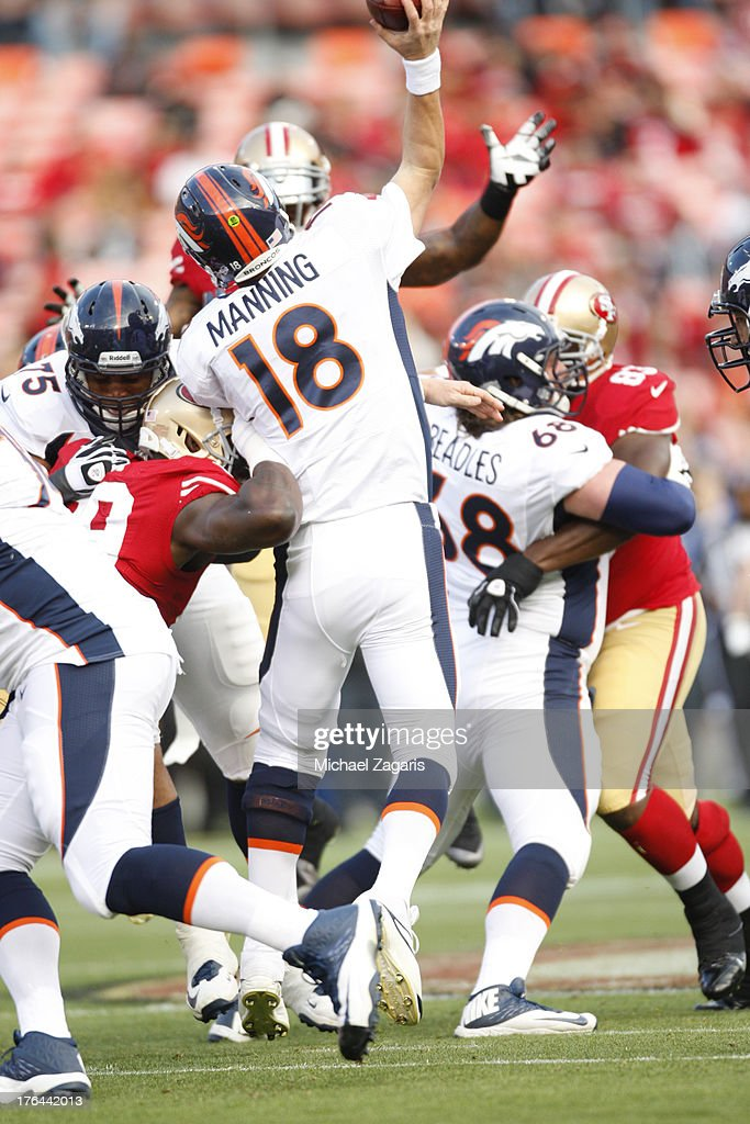Aldon Smith #99 of the San Francisco 49ers pressures Peyton Manning #18 of the Denver Broncos during the game at Candlestick Park on August 8, 2013 in San Francisco, California. The Broncos defeated the 49ers 10-6.