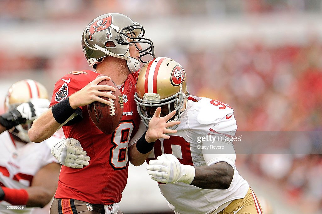 Aldon Smith of the San Francisco 49ers sacks Mike Glennon of the Tampa Bay Buccaneers during a game at Raymond James Stadium on December 15 2013 in...