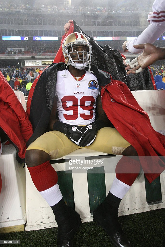 Aldon Smith #99 of the San Francisco 49ers sits on the bench during the game against the New England Patriots at Gillette Stadium on December 16, 2012 in Foxboro, Massachusetts. The 49ers defeated the Patriots 41-31.