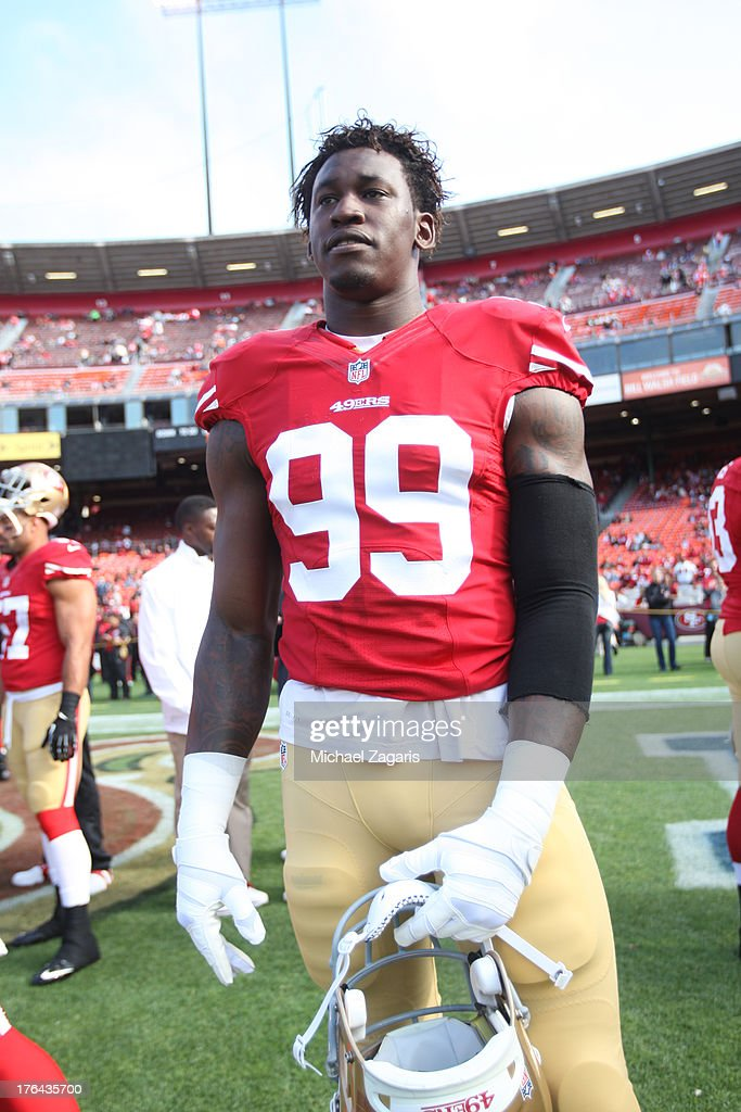 Aldon Smith #99 of the San Francisco 49ers stands on the field prior to the game against the Denver Broncos at Candlestick Park on August 8, 2013 in San Francisco, California. The Broncos defeated the 49ers 10-6.