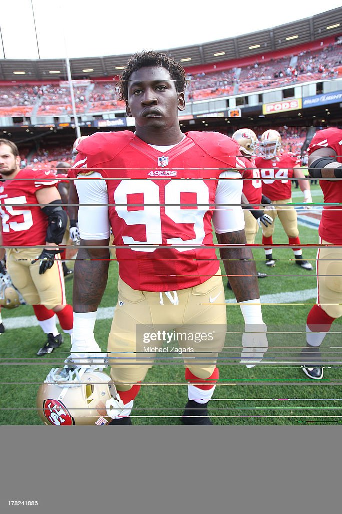 Aldon Smith #99 of the San Francisco 49ers stands on the field prior to the game against the Minnesota Vikings at Candlestick Park on August 25, 2013 in San Francisco, California. The 49ers defeated the Vikings 34-14.