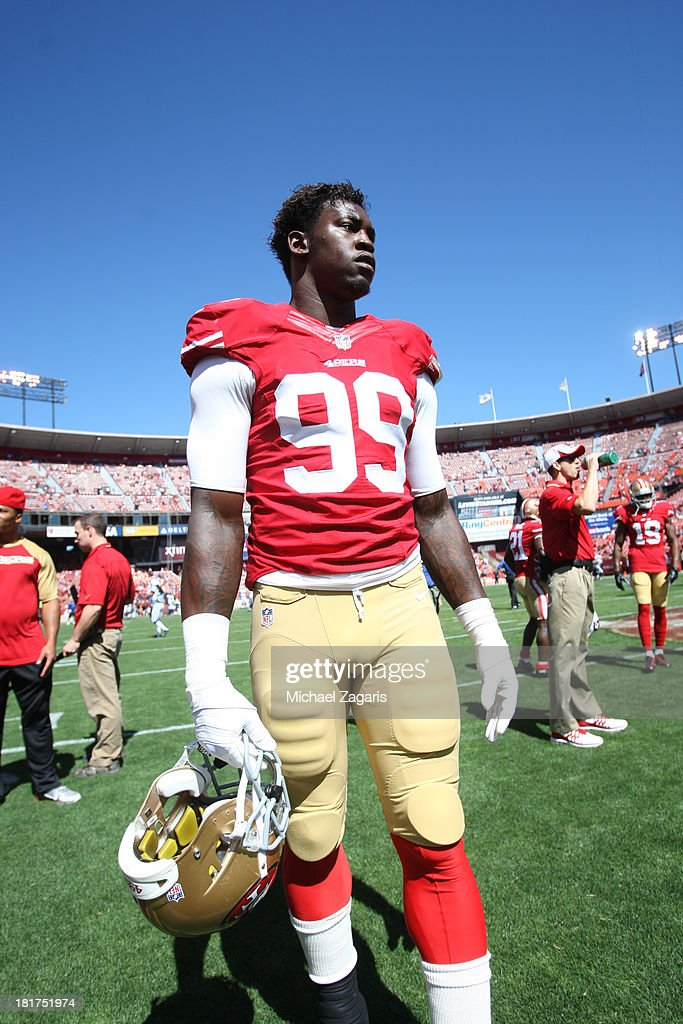 Aldon Smith #99 of the San Francisco 49ers stands on the field prior to the game against the Indianapolis Colts at Candlestick Park on September 22, 2013 in San Francisco, California. The Colts defeated the 49ers 27-7.
