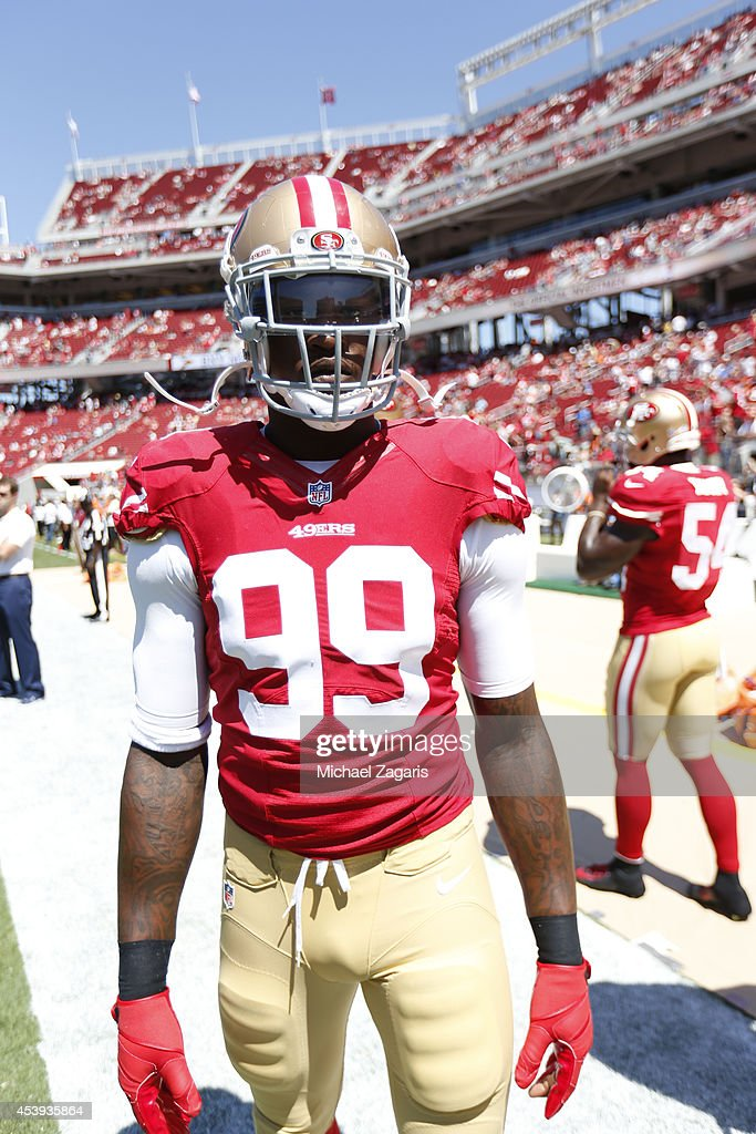 Aldon Smith of the San Francisco 49ers stands on the field prior to the game against the Denver Broncos at Levi Stadium on August 17 2014 in Santa...