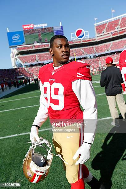 Aldon Smith of the San Francisco 49ers stands on the field prior to the game against the Arizona Cardinals at Levi Stadium on December 28 2014 in...
