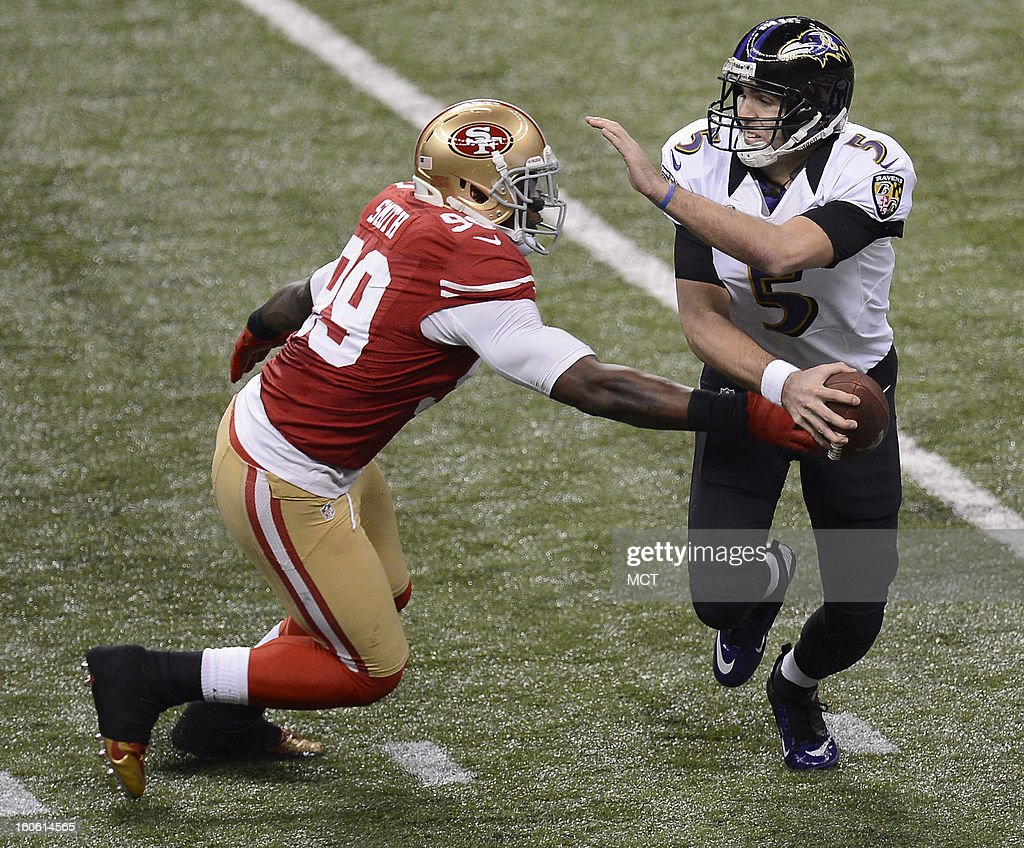 Aldon Smith (99) of the San Francisco 49ers tries to get his hands on Joe Flacco (5) of the Baltimore Ravens during first-half action in Super Bowl XLVII at the Mercedes-Benz Superdome in New Orleans, Louisiana, Sunday, February 3, 2013.