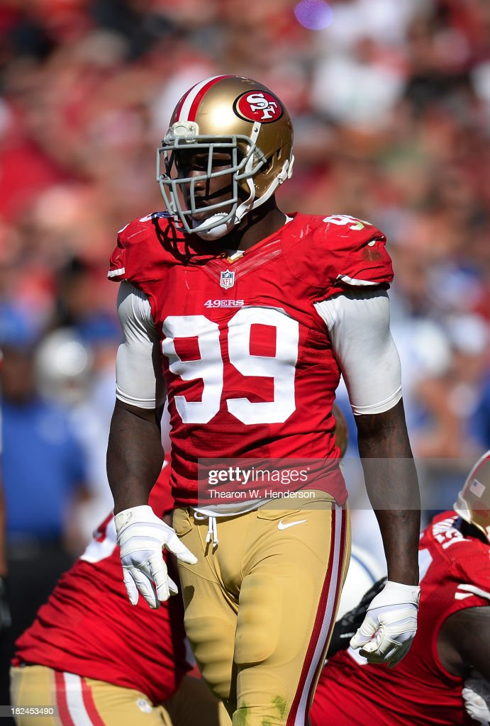 Aldon Smith #99 of the San Francisco 49ers walks off the field during the third quarter against the Indianapolis Colts at Candlestick Park on September 22, 2013 in San Francisco, California.