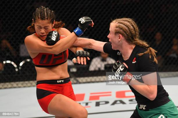 JJ Aldrich punches ChanMi Jeon of South Korea in their women's strawweight fight during the UFC Fight Night event at the Spark Arena on June 11 2017...