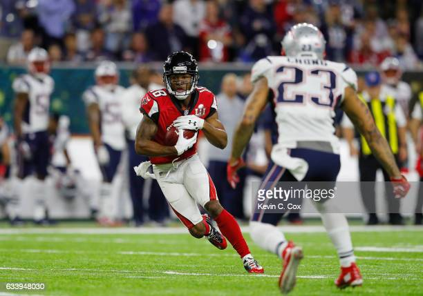 Aldrick Robinson of the Atlanta Falcons runs after a catch against Patrick Chung of the New England Patriots in the second quarter during Super Bowl...