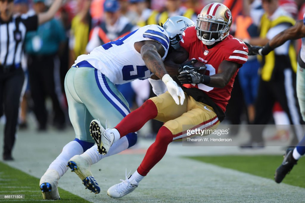 Aldrick Robinson #19 of the San Francisco 49ers is hit by Jaylon Smith #54 of the Dallas Cowboys during their NFL game at Levi's Stadium on October 22, 2017 in Santa Clara, California.