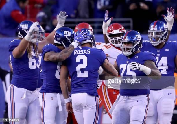 Aldrick Rosas of the New York Giants is congratulated by teammates Evan Engram and Jon Halapio of the New York Giants after Rosas kicked the game...