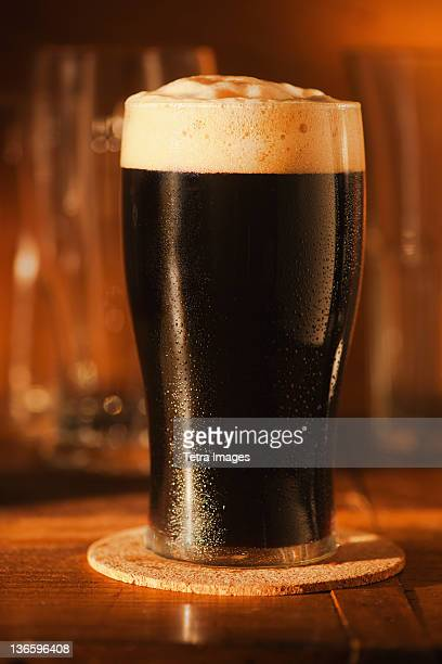 Ale in beer glass on bar counter