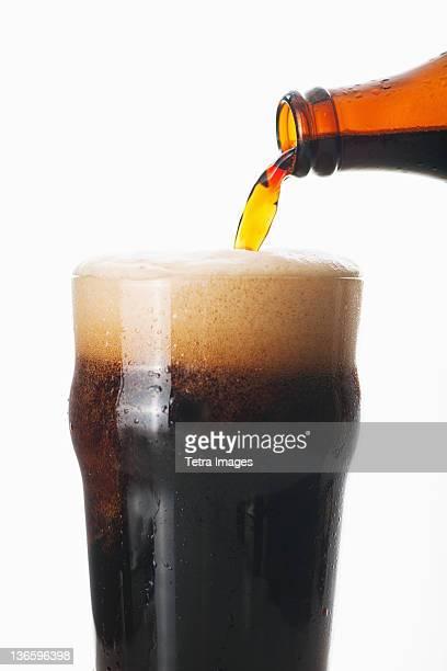 Ale pouring into glass, studio shot