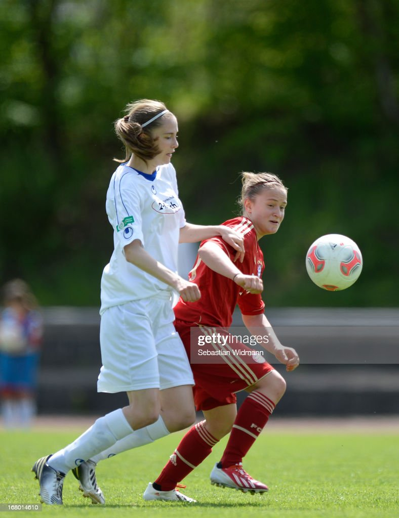 Alea Roeger of Muenchen challenges Bianca Bloechl of Sindelfingen during the B Junior Girls match between Bayern Muenchen and VfL Sindelfingen at Sportpark Aschheim on May 4, 2013 in Aschheim, Germany.