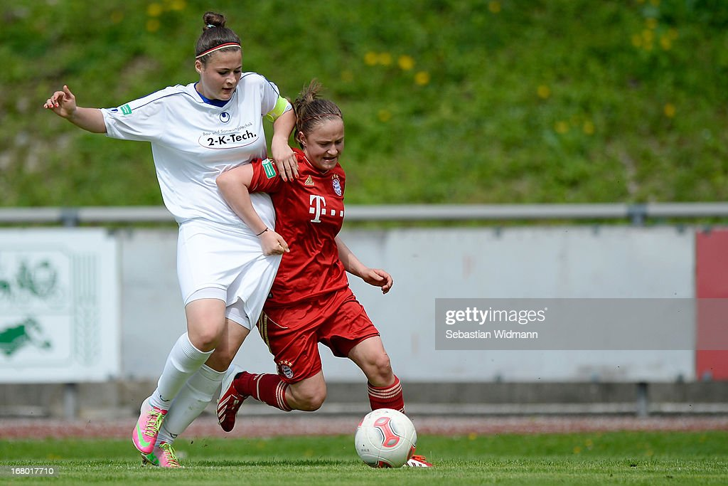 Alea Roeger of Muenchen challenges Paula Vorbeck of Sindelfingen during the B Junior Girls match between Bayern Muenchen and VfL Sindelfingen at Sportpark Aschheim on May 4, 2013 in Aschheim, Germany.