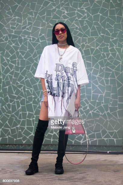 Aleali May wears Sacai Louis Vuitton Martine Ali and Rick Owens outside the Sacai show on June 24 2017 in Paris France