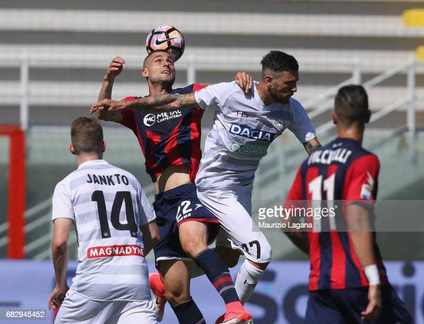 Aleandro Rosi of Crotone competes for the ball in air with Cyril Thereau of Udinese during the Serie A match between FC Crotone and Udinese Calcio at...