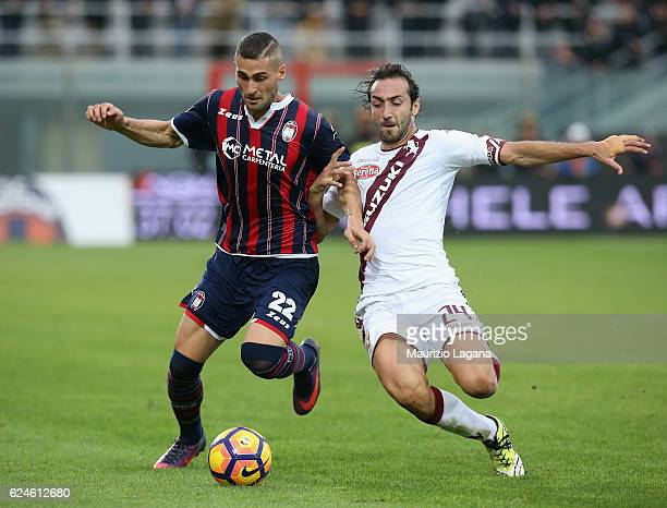 Aleandro Rosi of Crotone competes for the ball with Emiliano Moretti of Torino during the Serie A match between FC Crotone and FC Torino at Stadio...