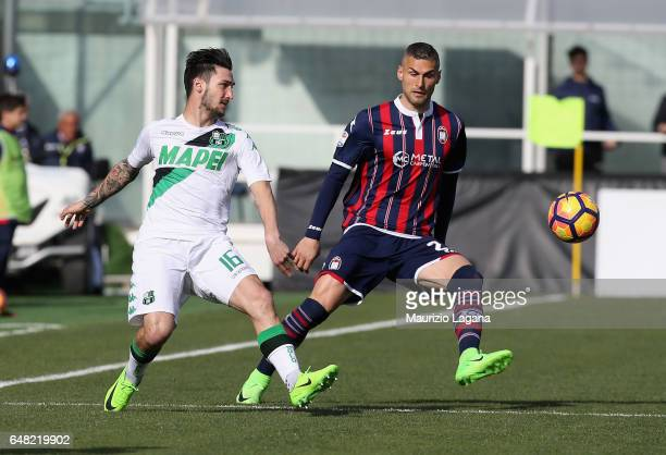 Aleandro Rosi of Crotone competes for the ball with Matteo Politano of Sassuolo during the Serie A match between FC Crotone and US Sassuolo at Stadio...