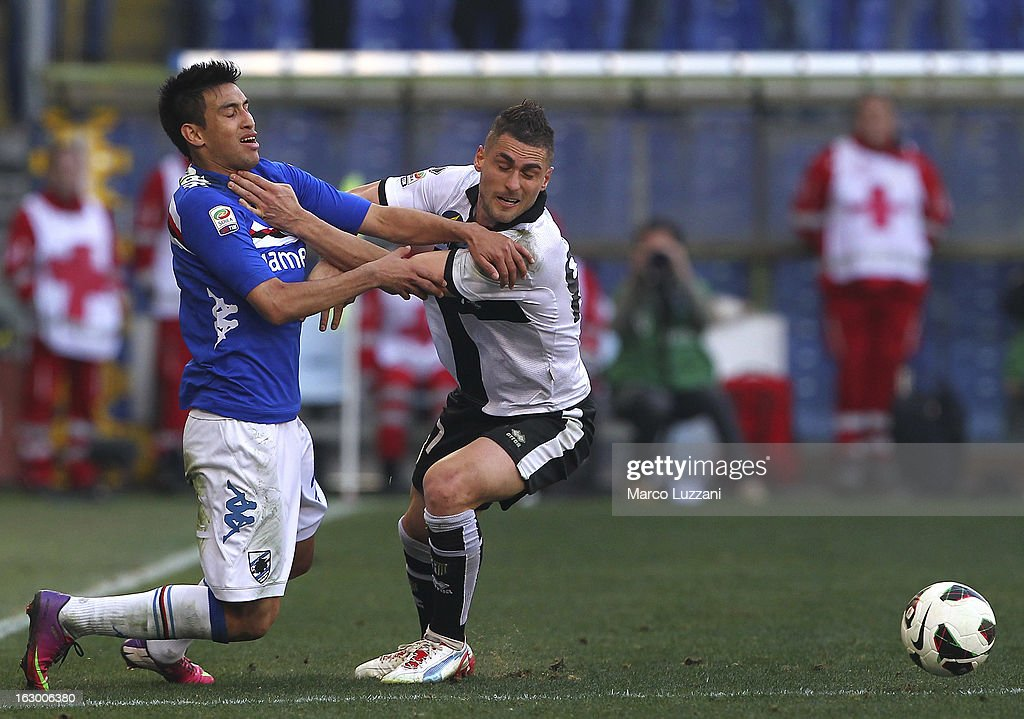 Aleandro Rosi (R) of Parma FC competes for the ball with <a gi-track='captionPersonalityLinkClicked' href=/galleries/search?phrase=Marcelo+Estigarribia&family=editorial&specificpeople=5356243 ng-click='$event.stopPropagation()'>Marcelo Estigarribia</a> (L) of UC Sampdoria during the Serie A match between UC Sampdoria and Parma FC at Stadio Luigi Ferraris on March 3, 2013 in Genoa, Italy.