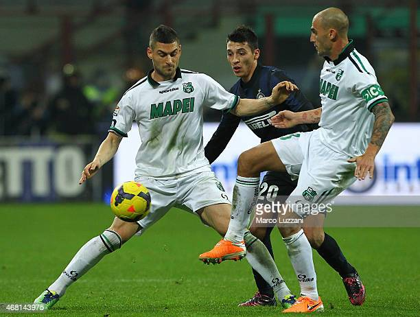 Aleandro Rosi of US Sassuolo Calcio competes for the ball with Ruben Botta of FC Internazionale Milano during the Serie A match between FC...