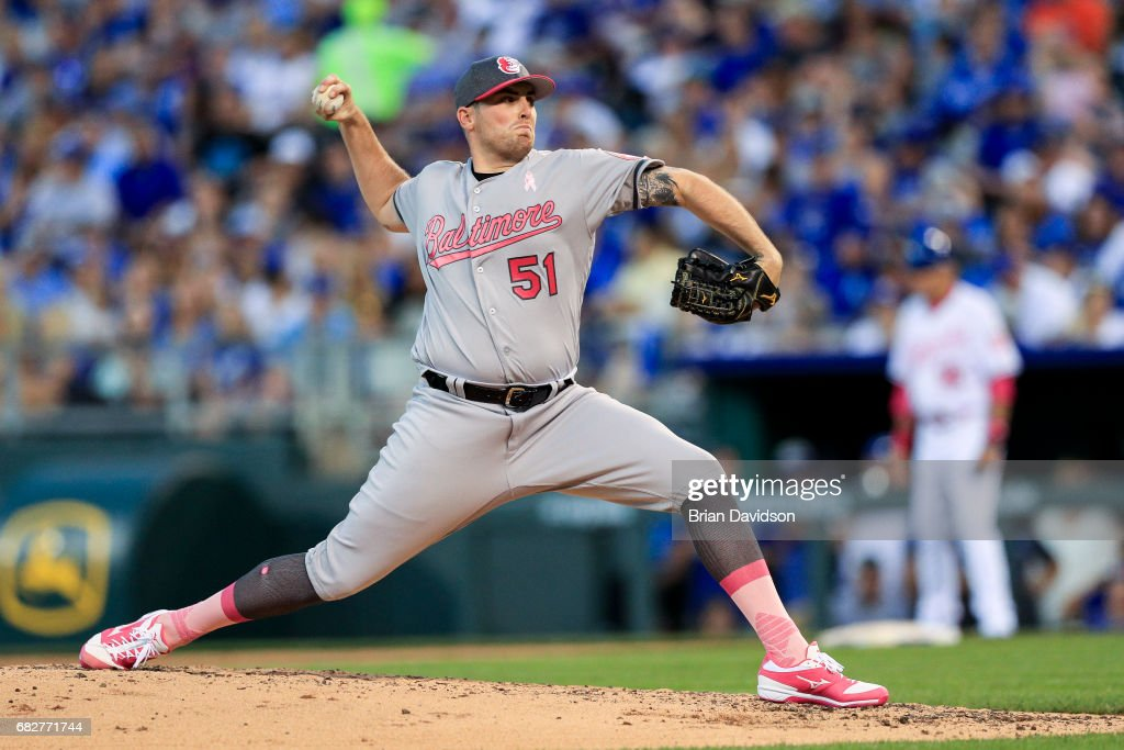 Alec Asher #51 of the Baltimore Orioles pitches against the Kansas City Royals during the fifth inning at Kauffman Stadium on May 13, 2017 in Kansas City, Missouri. Players are wearing pink to celebrate Mother's Day weekend and support breast cancer awareness.